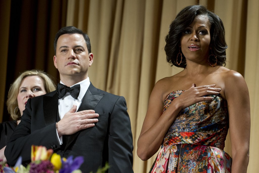 Michelle Obama and Jimmy Kimmel rose for the pledge of allegiance.