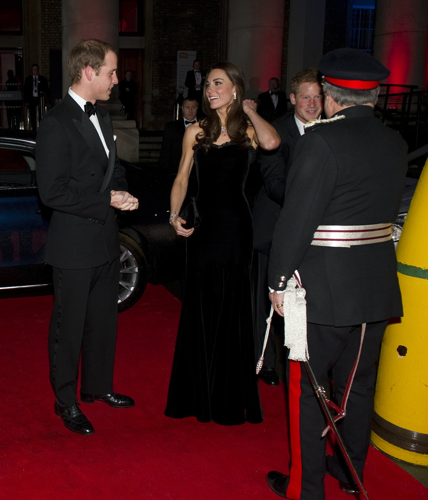 Kate pushed her hair back at the Sun Military Awards in London in Dec. 2011.