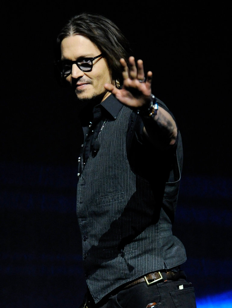 Johnny Depp gave a wave to fans at CinemaCon in Las Vegas.