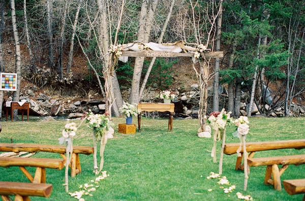"""Alongside natural, rustic details, the simple word """"Beloved"""" stands out as a sweet, unexpected touch. Photo by Smitten Photography via Style Me Pretty"""
