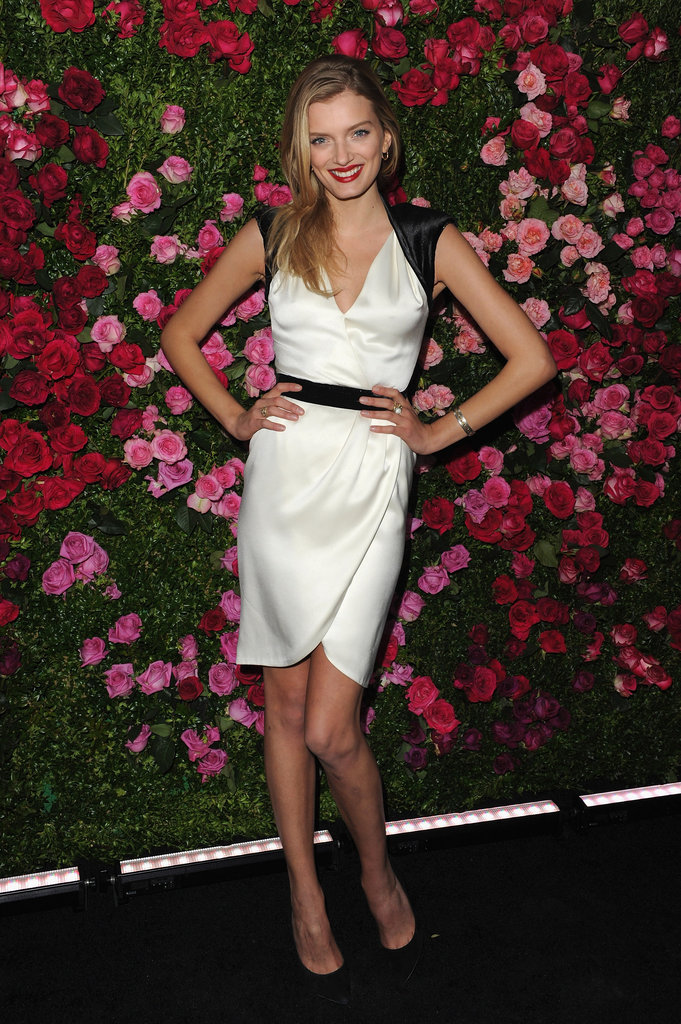 Lily Donaldson wore a white silk dress with black cap sleeves to the Chanel dinner party at the 2012 Tribeca Film Festival.