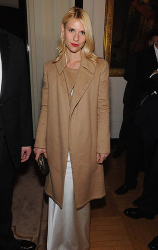 Claire Danes covered up in a coat at the White House Correspondant's Dinner.