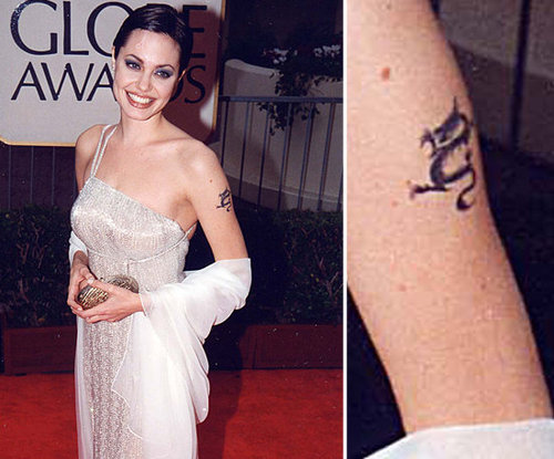 Angelina Jolie had a dragon tattoo in the 1990s but has since had it removed. At one point, she had three dragon tattoos.