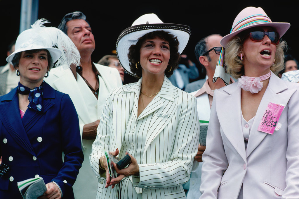 Three women in suits and hats cheered during the 1977 Kentucky Derby.