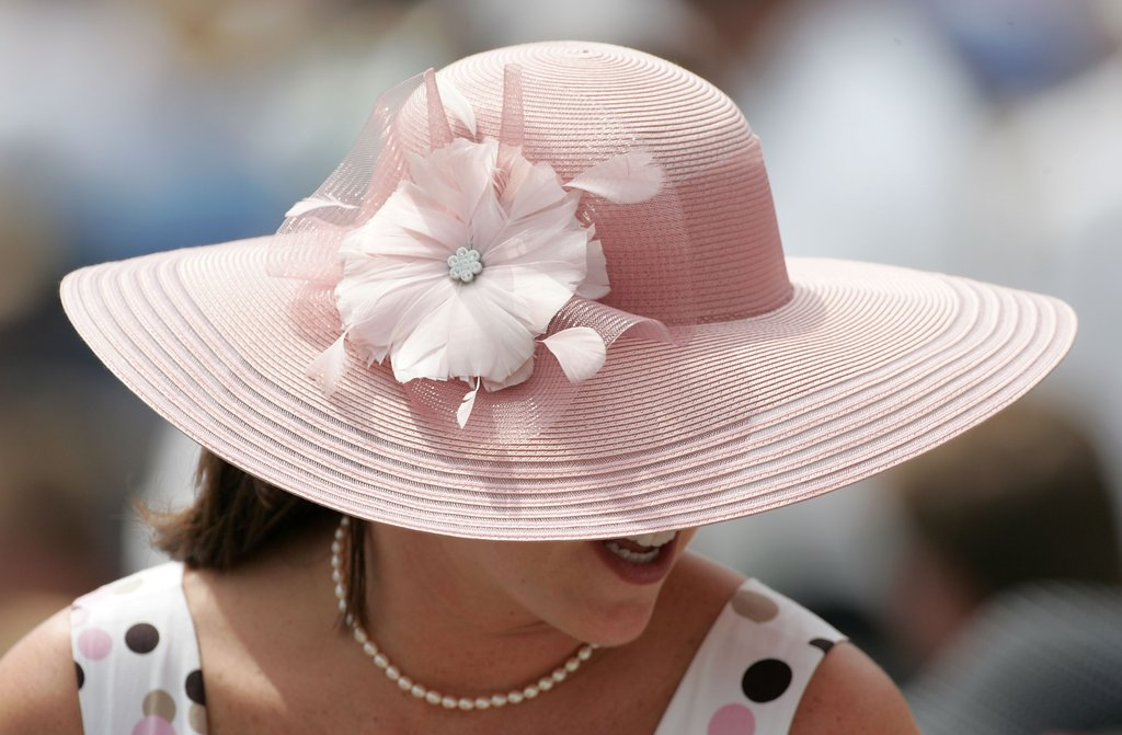 A spectator was seen in the grandstand wearing her light-pink hat in 2007.