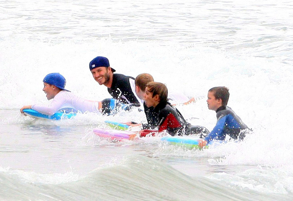 In August 2011, David Beckham joined his sons in the surf during their stay in Malibu, CA.