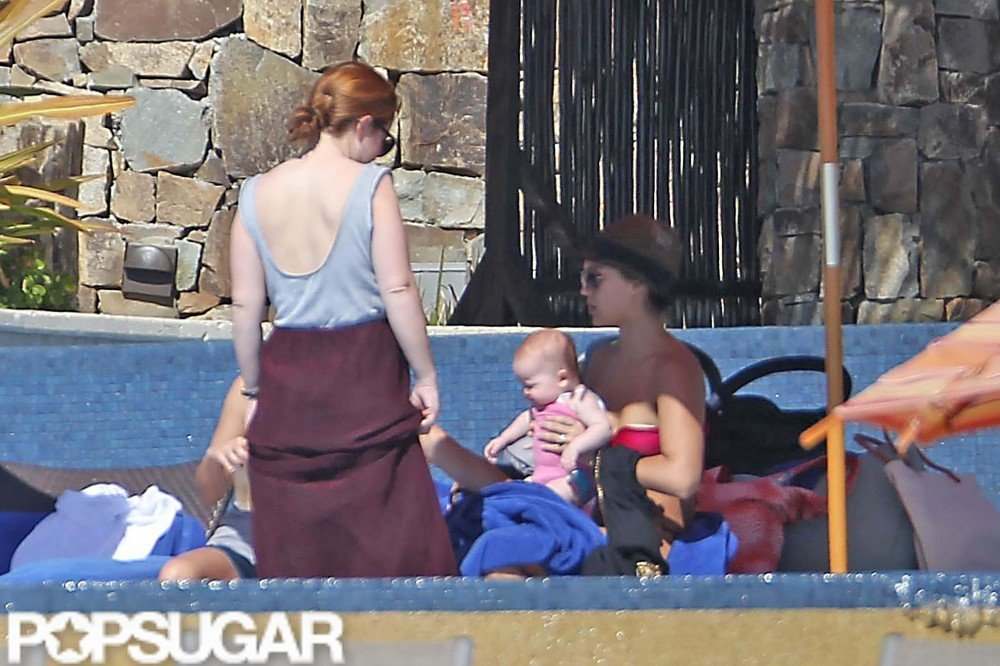 Jessica Alba spent New Year's Eve 2011 hanging poolside with her friends and family in Cabo.