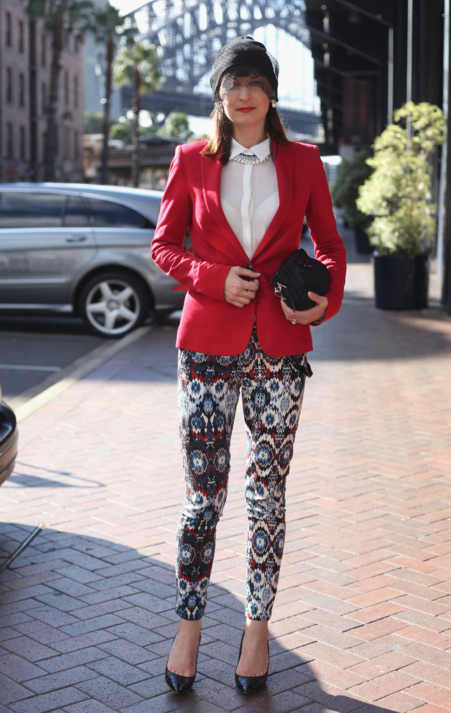 Are you feeling this red blazer, printed Zara jeans ensemble?