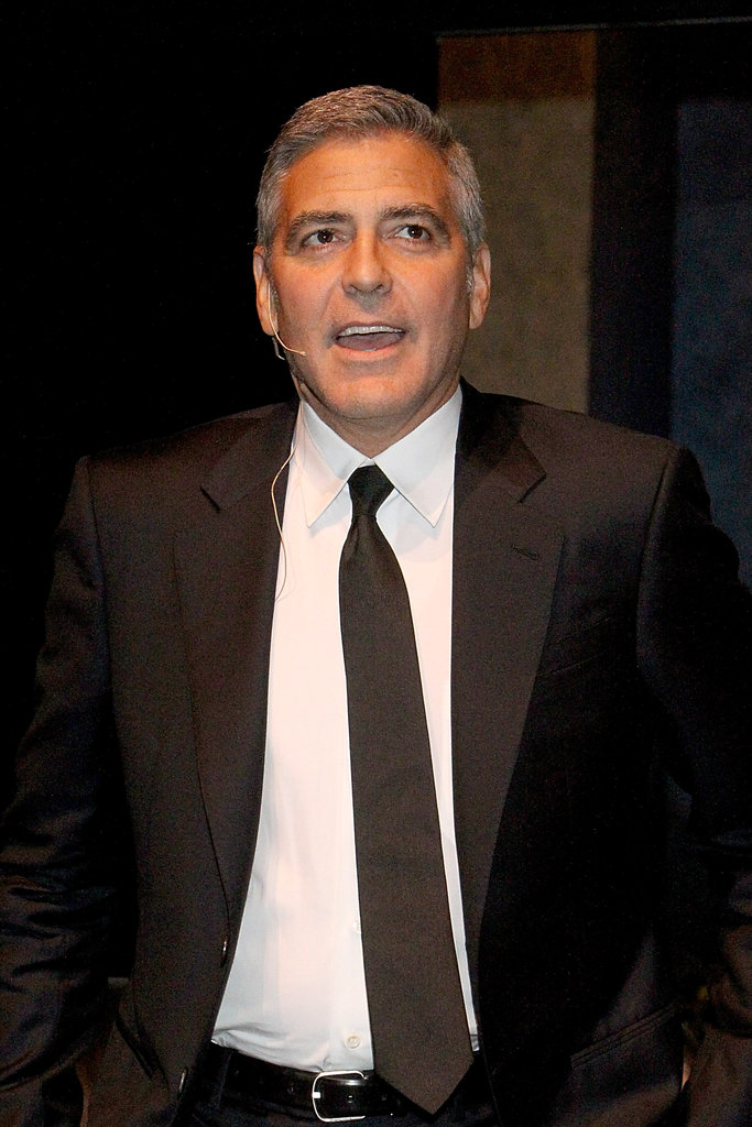 George Clooney wore an all-black suit to an interview with Lynn Wyatt in Houston.