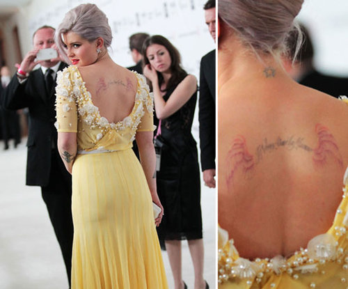 "Kelly Osbourne has multiple pieces on her back including a star on her neck and the words ""I love my mommy"" in French."