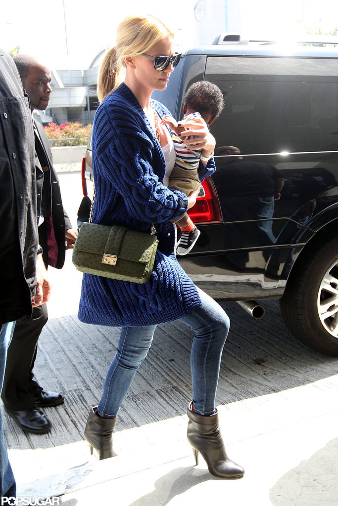 Charlize Theron carried son Jackson into the airport in LA.