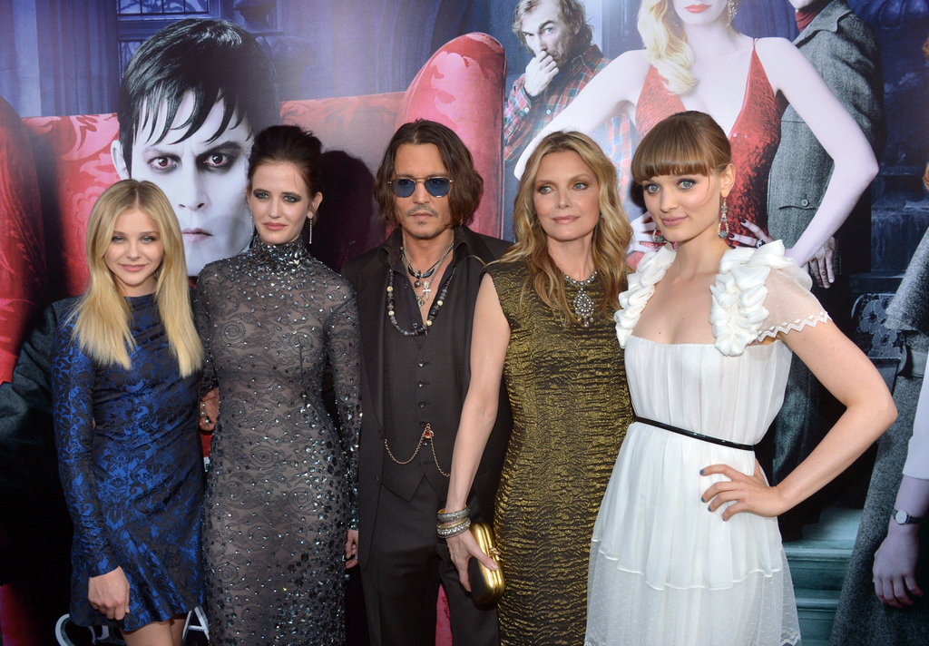 Johnny Depp, Michelle Pfeiffer, Bella Heathcote, Chloe Moretz, and Eva Green all huddled up for a picture at the LA premiere of Dark Shadows.
