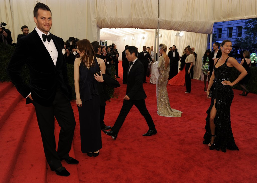 Gisele Bundchen posed while husband Tom Brady looked on at the Met Gala.