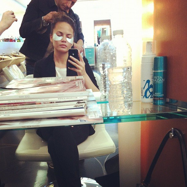 Chrissy Teigen wore undereye patches while getting her hair and makeup done.  Source: Twitter User chrissy_teigen