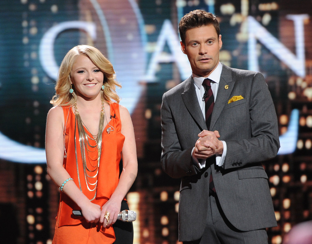 Hollie Cavanagh stood with Ryan Seacrest while waiting for the judges' reactions.