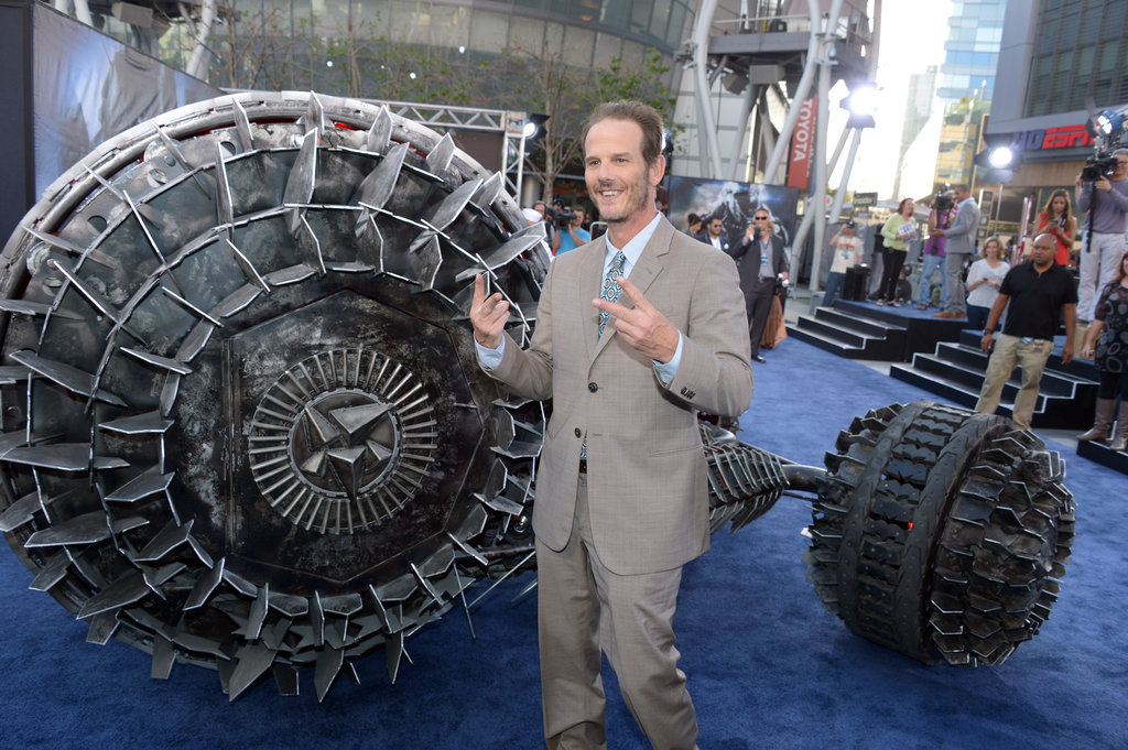 Peter Berg posed with some props at the premiere of Battleship in LA.