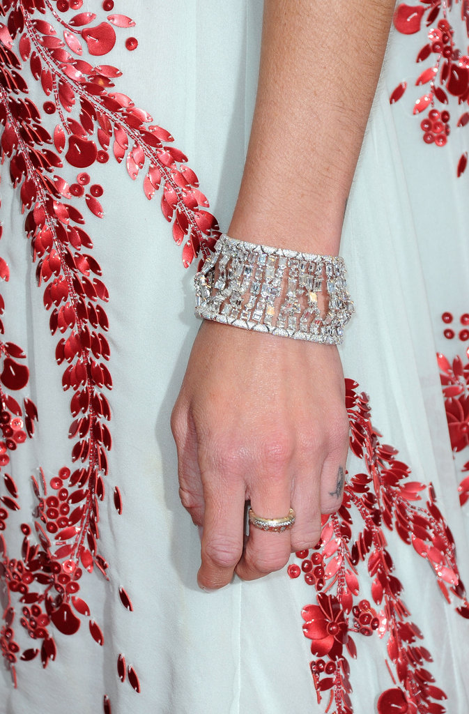 Erin paired a gorgeous diamond cuff with her embellished red leather petal Antonio Berardi dress.