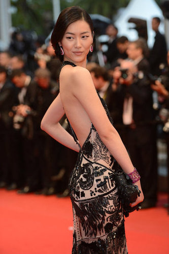 Liu's backless gown wasn't the only thing that caught our attention. We love that she chose a dark pink jewel-encrusted cuff to offset the dark tone of her dress, too.