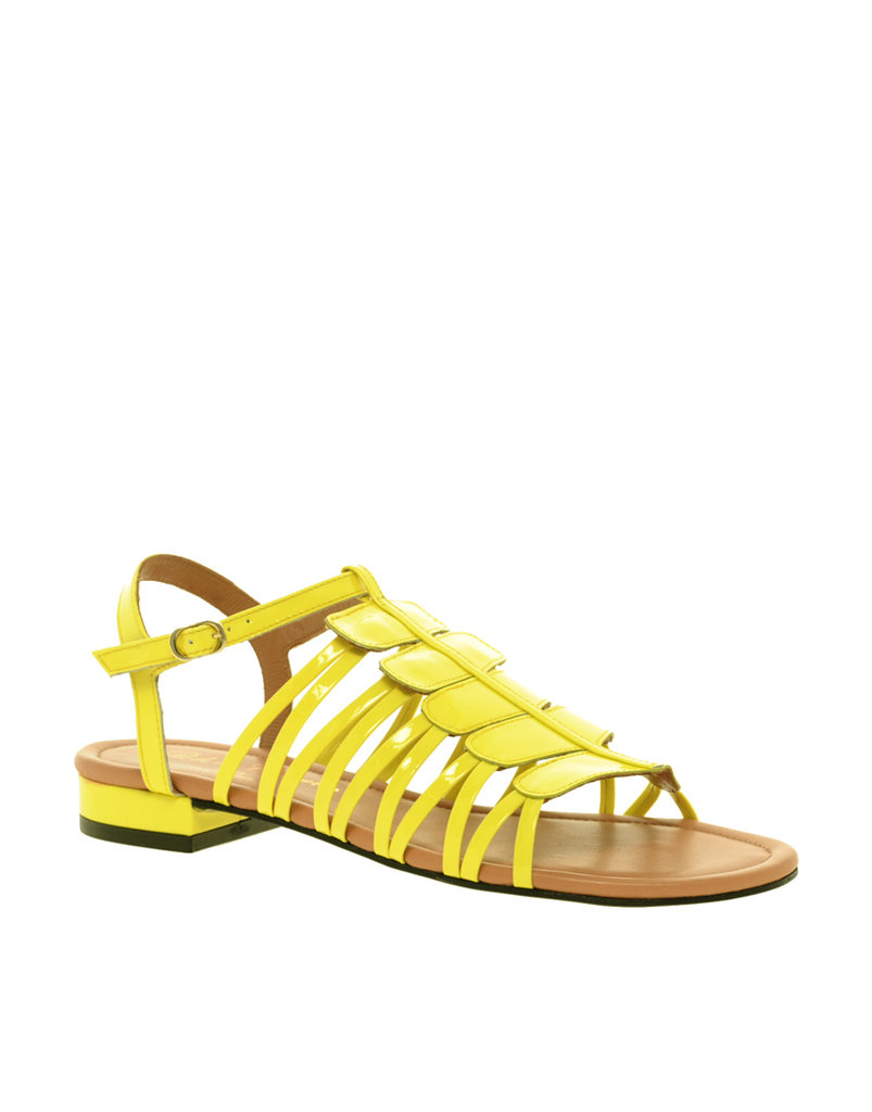 We love the citrus hue on this pair — just the thing to add to a cool colorblocked look.  Robert Clergerie Boa Patent Flat Sandals ($575)