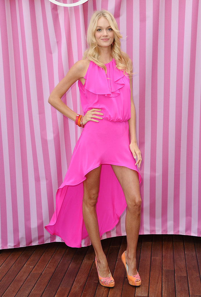 Victoria's Secret Angel Lindsay Ellingson made a case for wearing hot pink during the day — her floaty asymmetrical-hem frock makes a great daytime look, and does double-duty as a chic beach coverup.