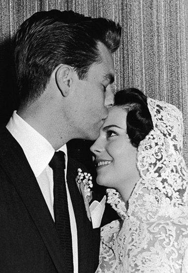 Robert Wagner Plants a Kiss on Natalie Wood