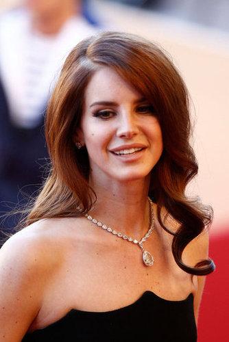 Lana Del Rey paired a diamond pendant necklace with her scalloped-neckline Alberta Ferretti gown.
