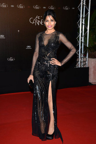 Freida Pinto changed up her look for the film festival's opening night dinner, opting for a moody, embellished Versace gown.
