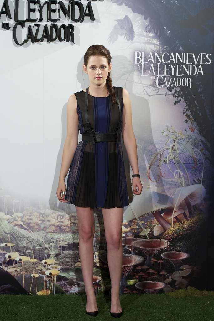 Kristen Stewart wore a lace-paneled, fit-and-flare dress paired and black leather harness belt by BCBG Max Azria paired with sleek black pumps to the Madrid photocall of Snow White and the Huntsman.