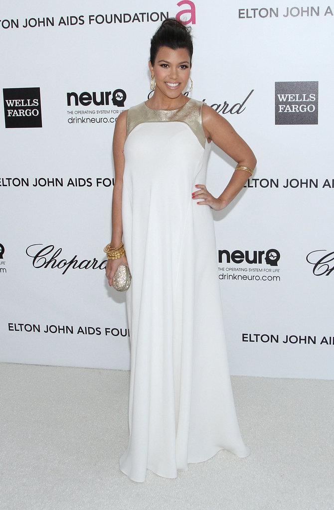 Kourtney Kardashian wore a white-and-gold Raoul gown to Elton John's Oscars viewing party.