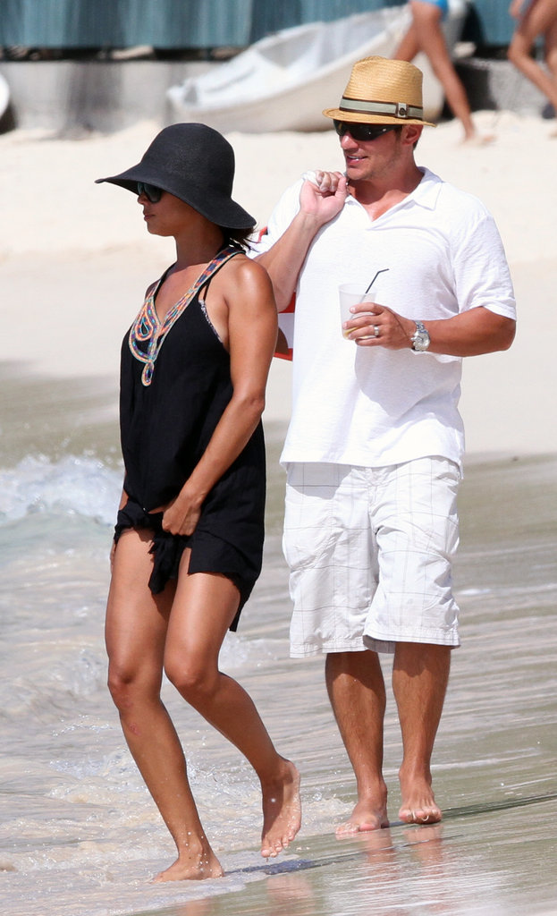 Nick and Vanessa Lachey hit the beach together in sun hats while on a vacation in St. Barts in July 2011.