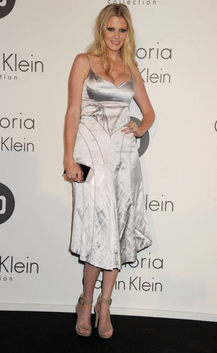 Model Lara Stone chose a silver Calvin Klein slip dress and nude ankle-strap heels for the Women in Film party.