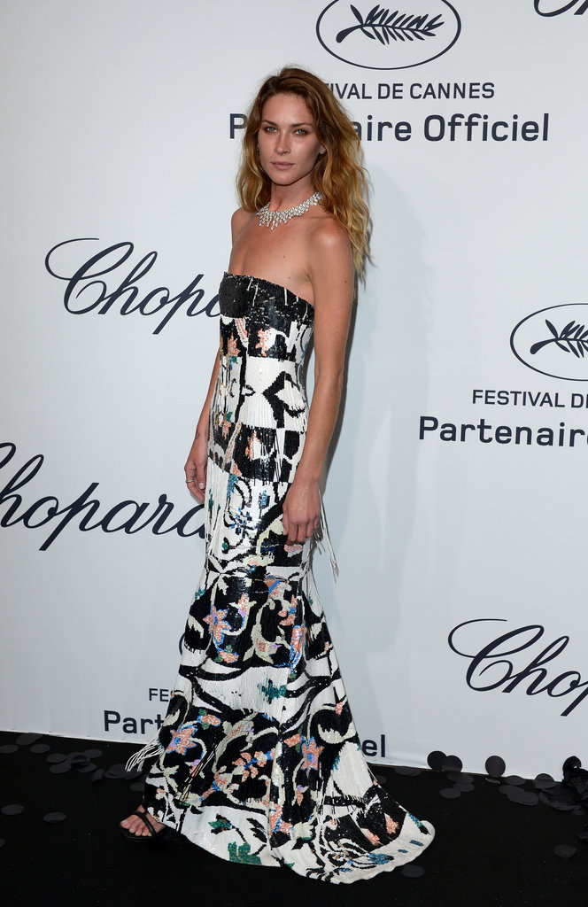 Erin Wasson headed to Chopard's fete in a fringed and beaded Oscar de la Renta gown.