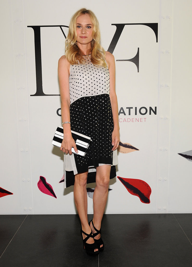 Diane Kruger has never met a printed dress she doesn't like —she wore a polka-dot Diane von Furstenberg frock to an event recently, pairing it with an equally chic, graphic black and white clutch and black strappy heels.