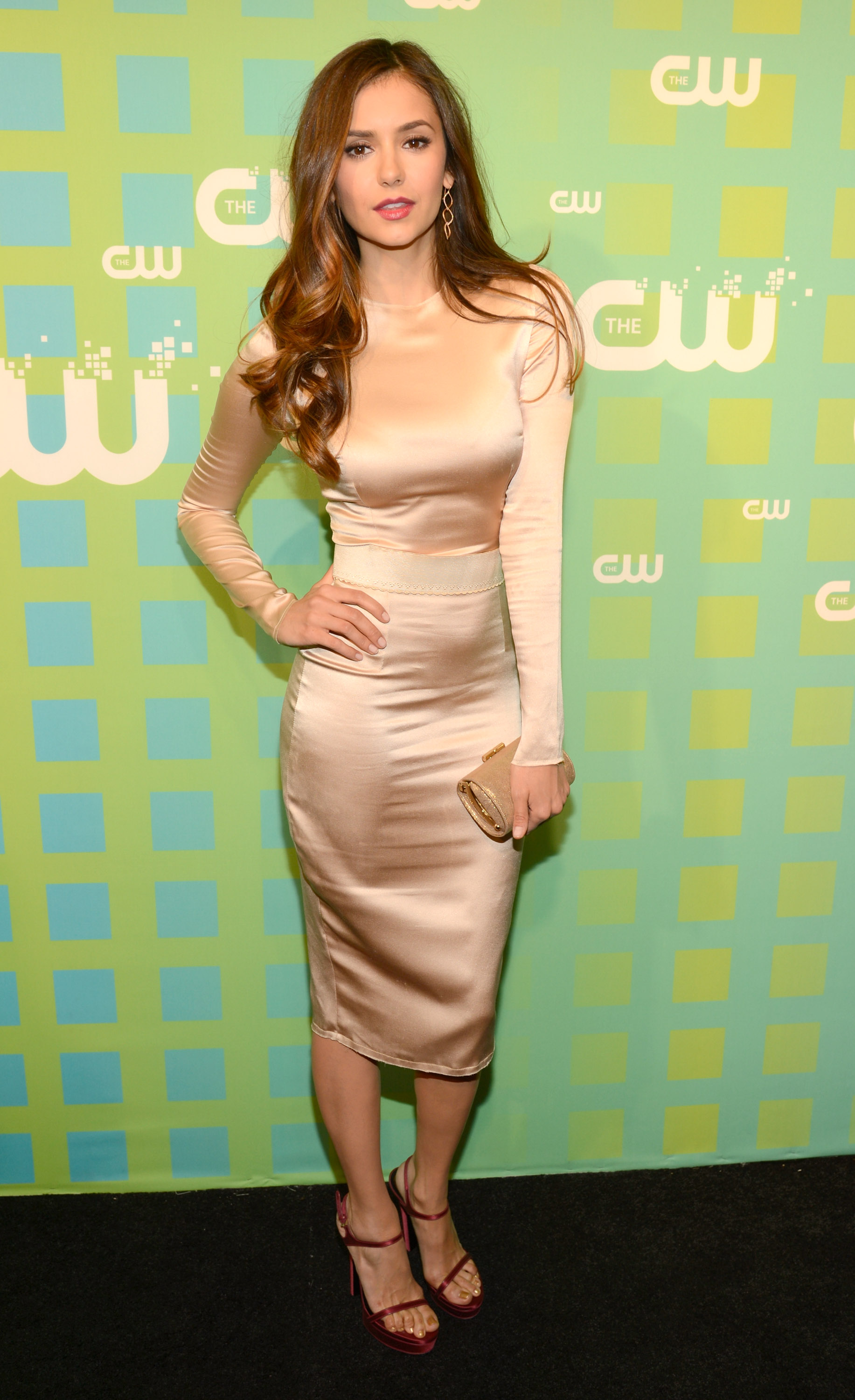 At The CW's 2012 upfronts, Nina glimmered in a long-sleeved Dolce & Gabbana frock and red sandals.