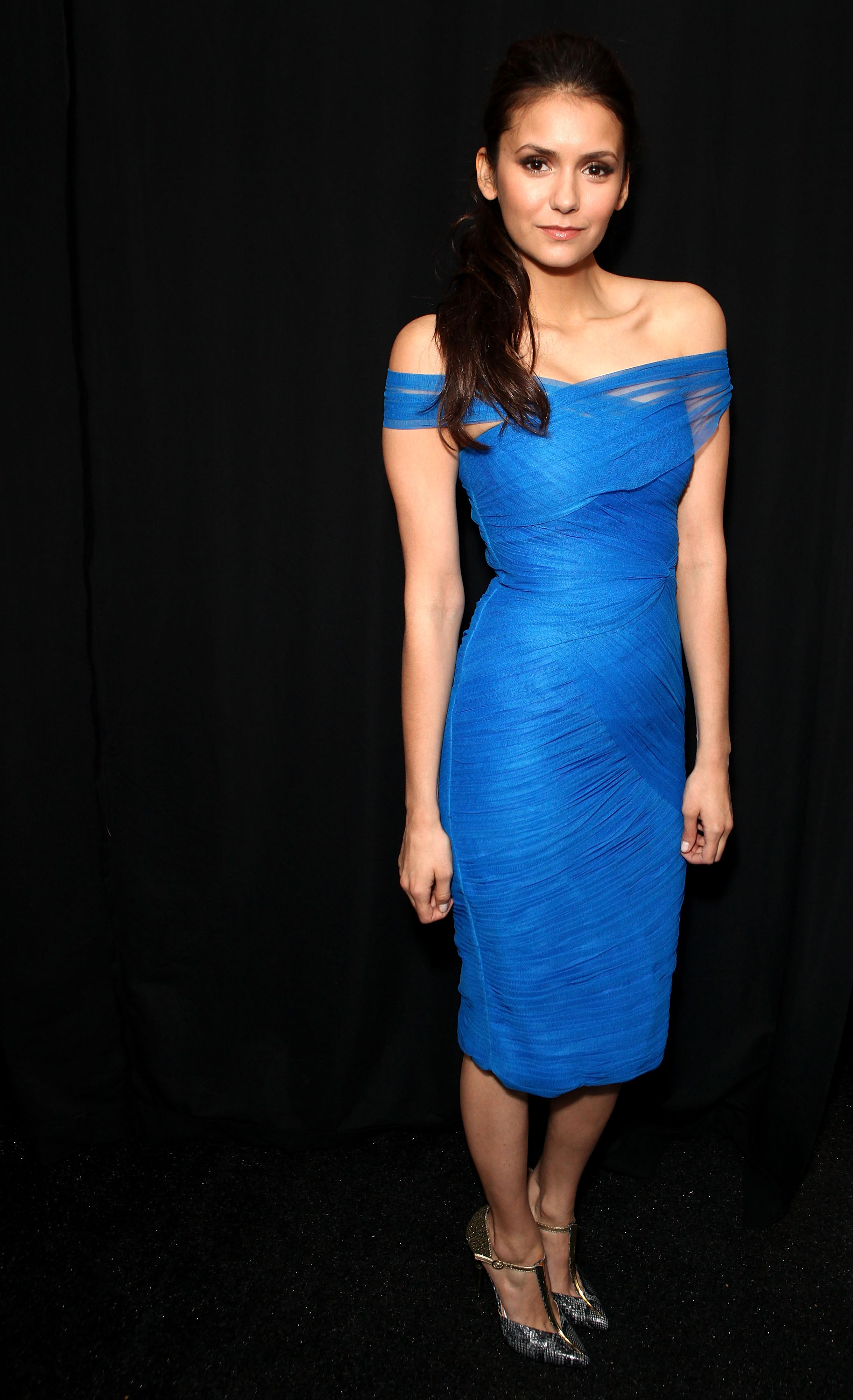 The actress donned a beautiful blue Monique Lhuillier creation at the designer's Fall '12 runway show.