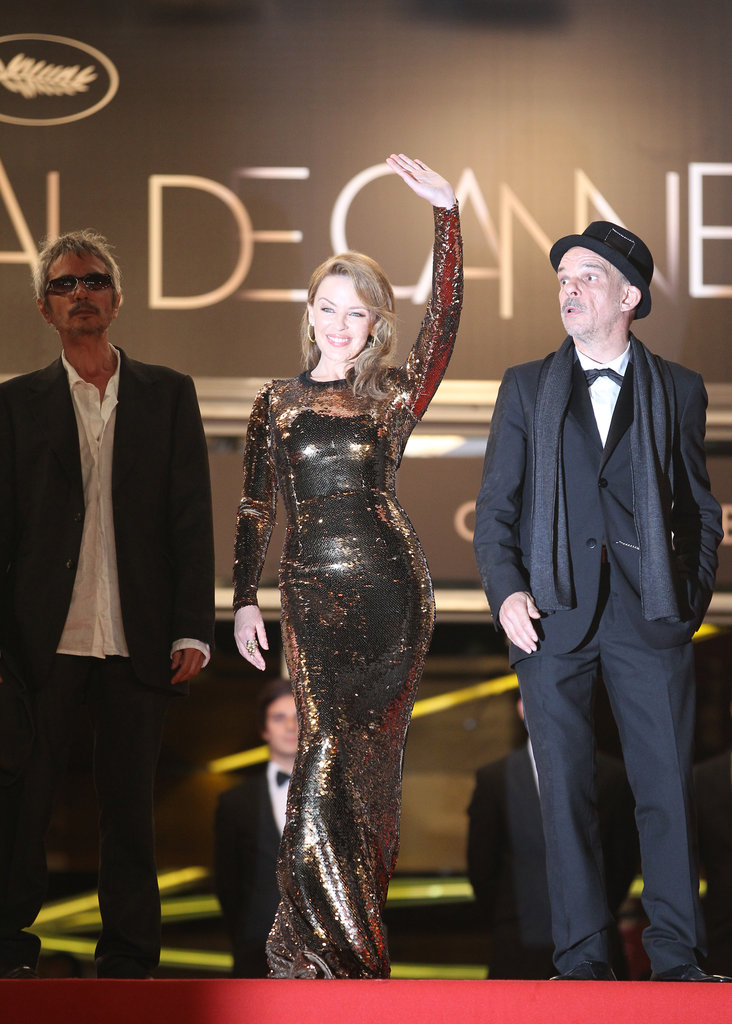 Kylie Minogue made a glamazon arrival in curve-hugging gold sequins.