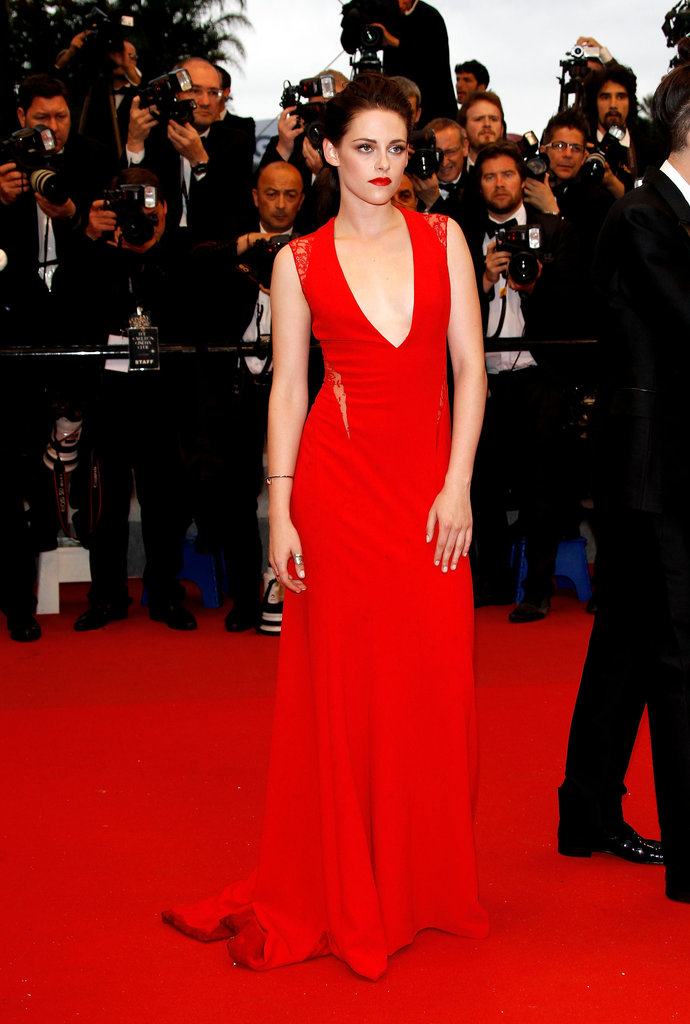 Kristen Stewart posed in her jaw-dropping Reem Acra red — with lips to match — at the Cosmopolis premiere.