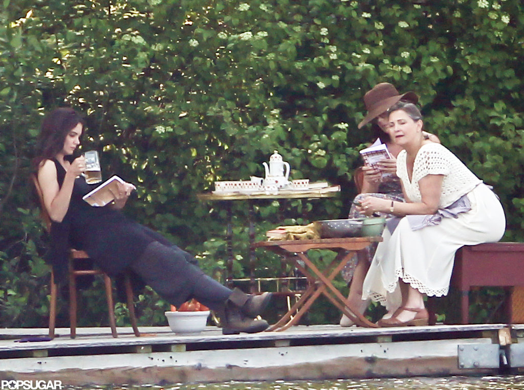 Katie Holmes pretended to read a book while on set shooting her next film.