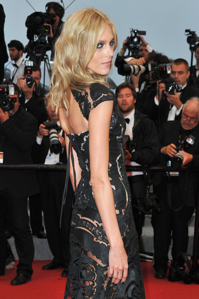 Anja Rubik smolders in a laser-cut gown — complete with lots of sultry back cutouts.