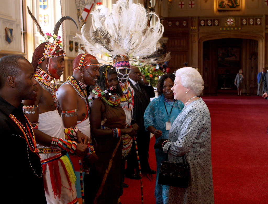 Queen Elizabeth II met Kenyan tribesmen during a tea party for the cast of the Diamond Jubilee Pageant at Windsor Castle on May 11.