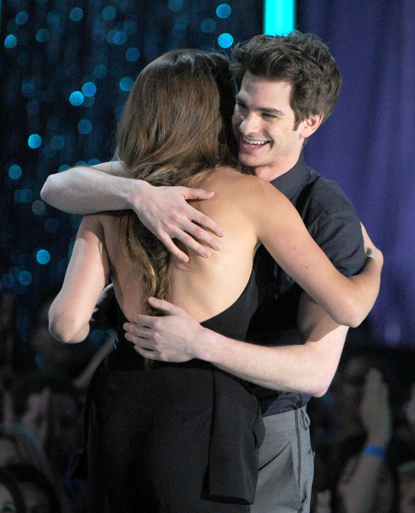 Andrew Garfield hugged Shaliene Woodley and presented her a golden popcorn for best breakthrough performance.