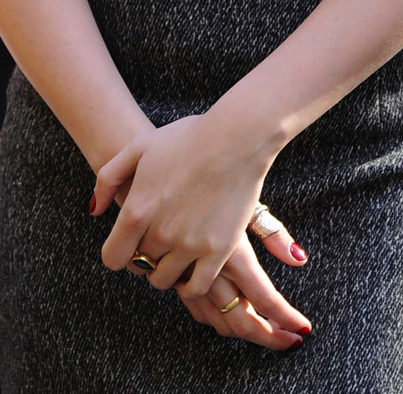 A close-up of Kristen's cool-girl rings, including a Melinda Maria black onyx ring.