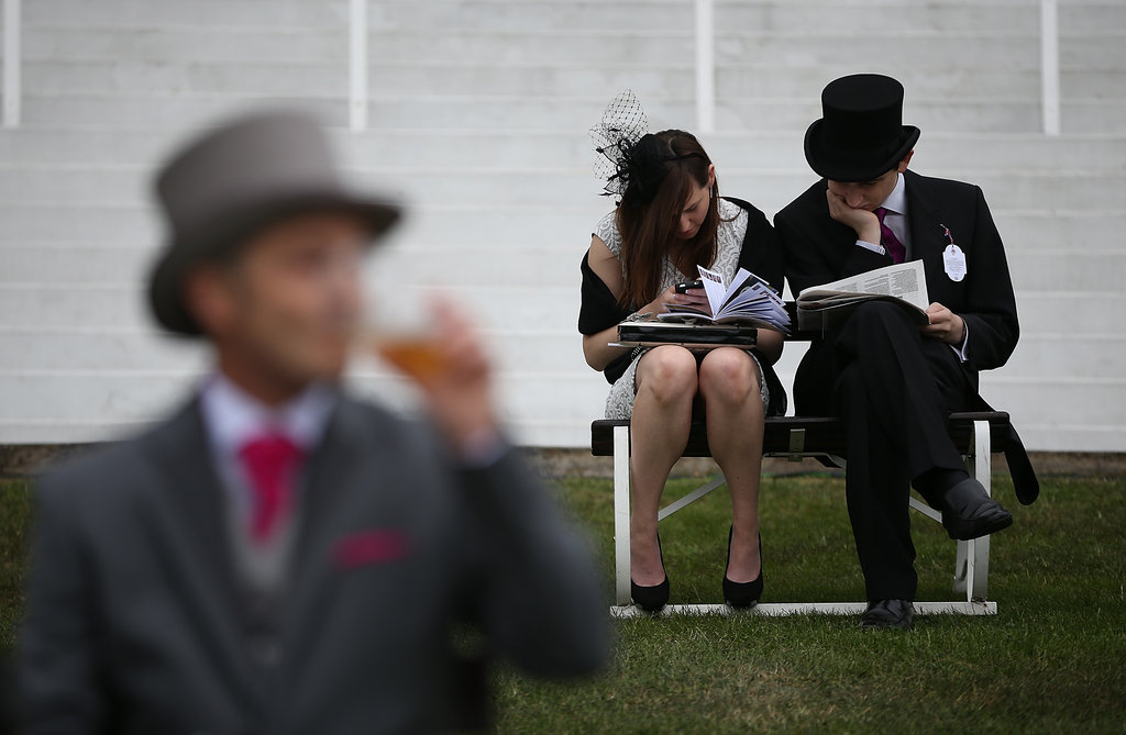 A couple sat together at the derby.