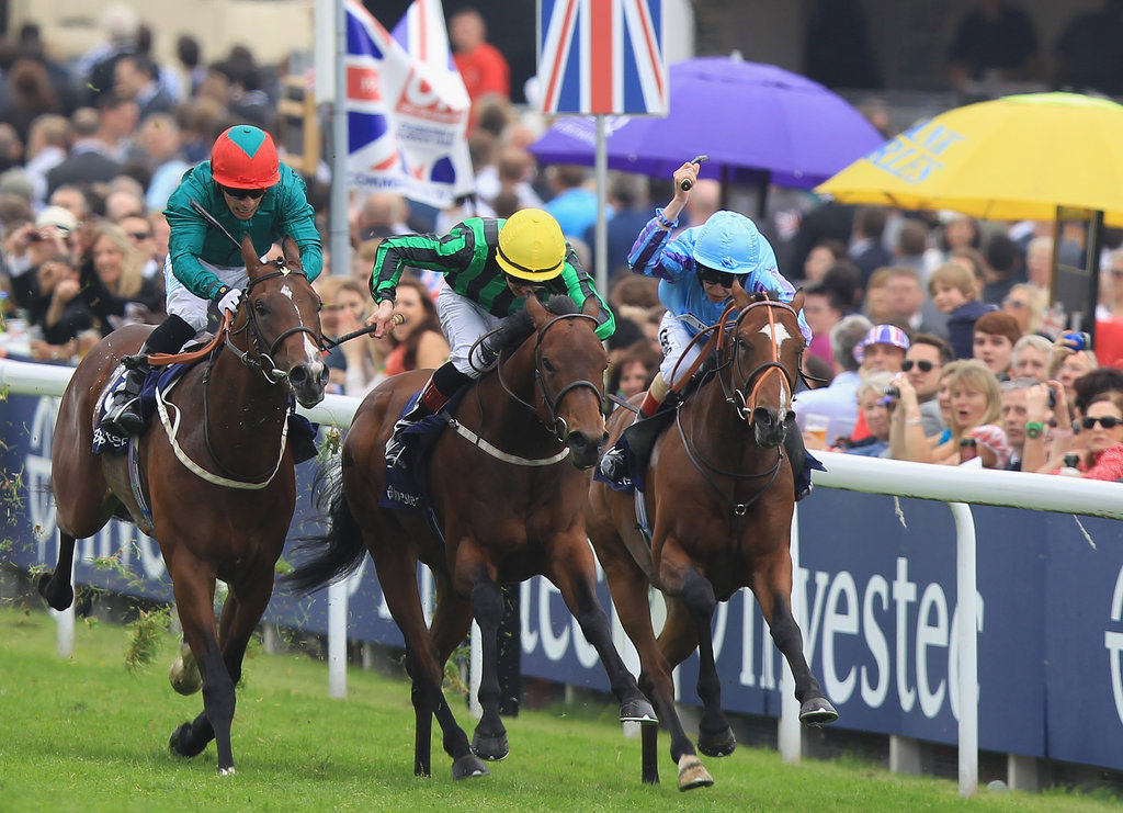 The jockeys raced at the Diamond Jubilee Derby.