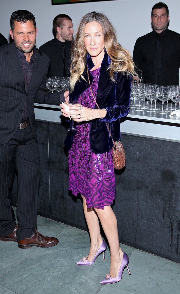 While attending a party at the MoMA in NYC, SJP went for a monochromatic color scheme donning an embellished magenta Oscar de la Renta dress with lilac Manolo Blahnik satin pumps, then layered a blue velvet Yves Saint Laurent blazer and Fred Leighton jewels for extra flair. 7093471