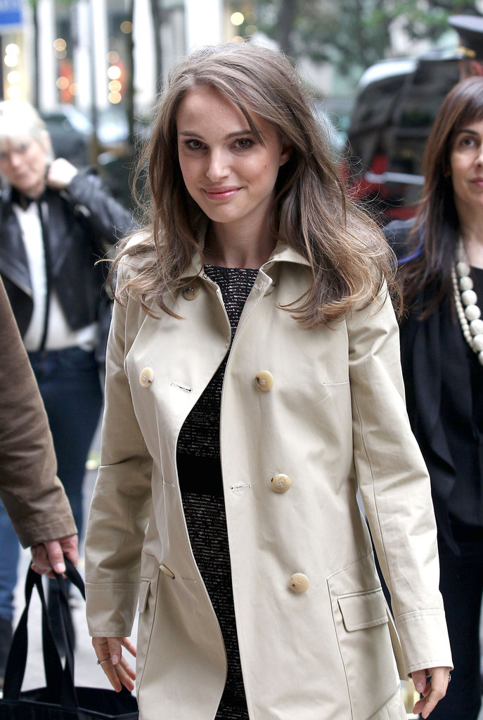 Natalie Portman gave a smile during a shopping trip in Paris in April 2012.