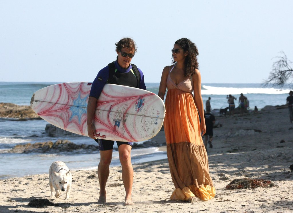 Camila Alves headed to the beach in Malibu while Matthew McConaughey surfed in May 2009.