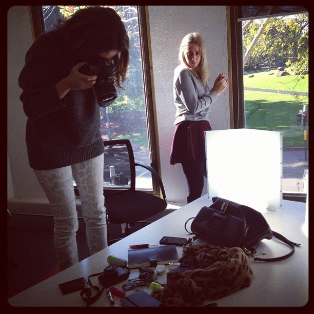 "Behind the scenes with Marisa shooting Alison's Handbag Confessions post. ""We need more light!"""
