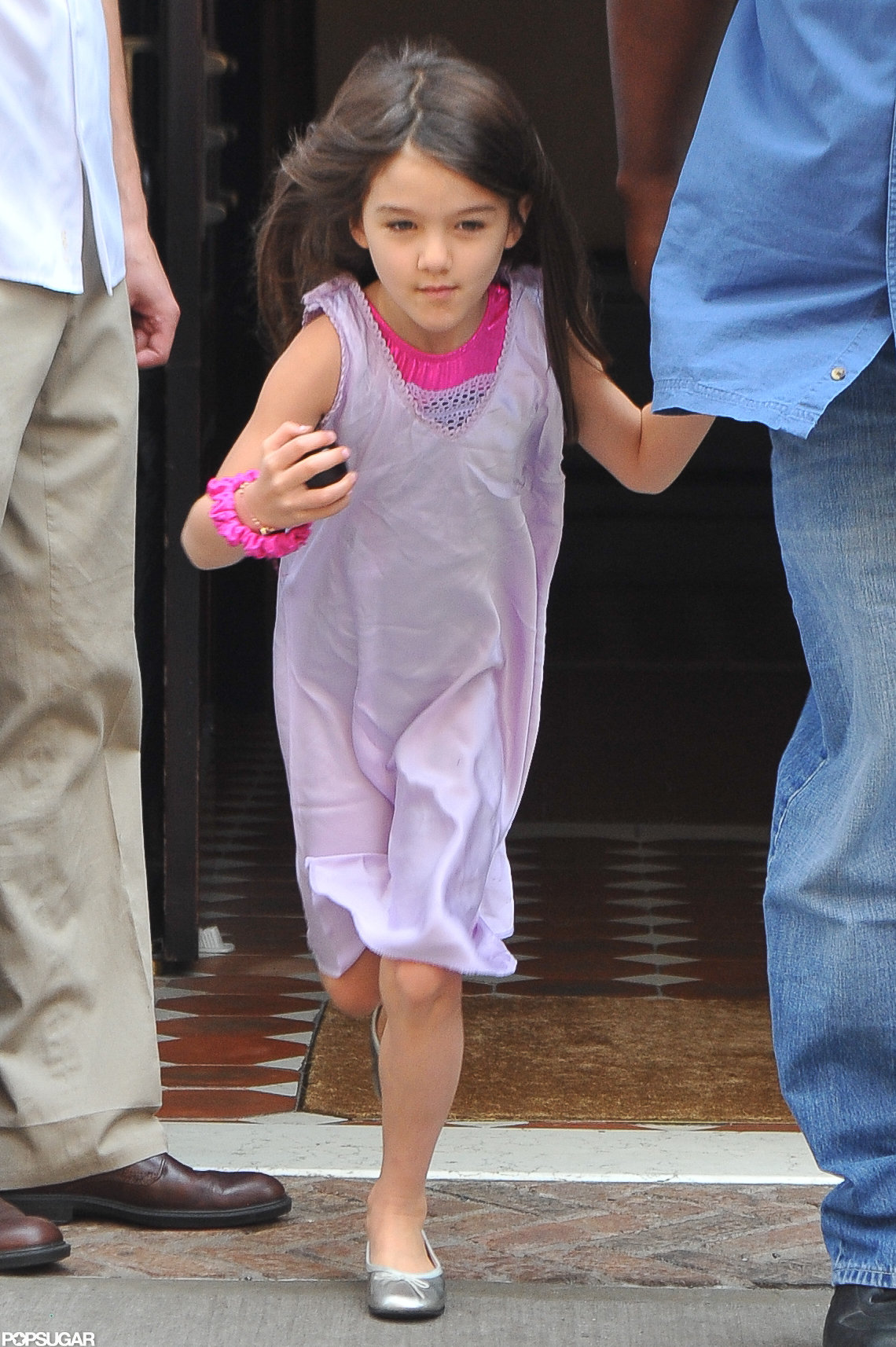 Suri Cruise looked cute wearing pink and purple in NYC.