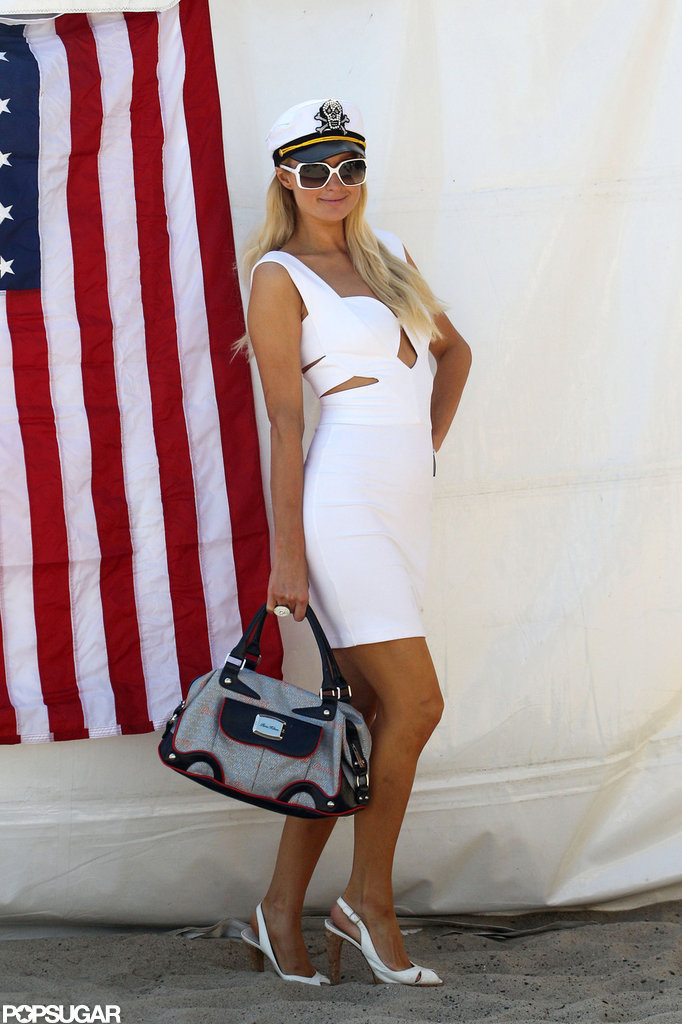 Paris Hilton posed with a flag in the background before a Fourth of July party in Malibu, CA, in 2011.